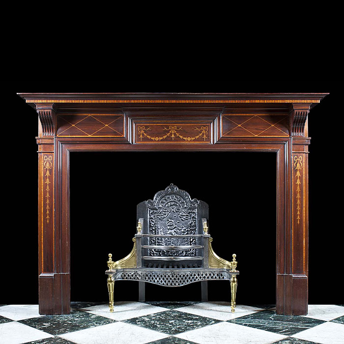 An Antique Edwardian Mahogany and Satinwood fireplace mantel