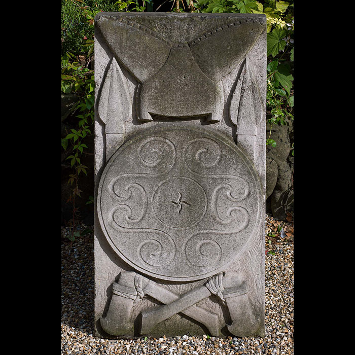 A garden wall plaque carved in Portland Stone