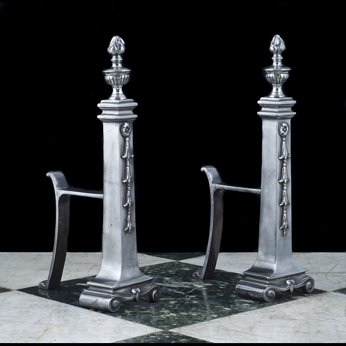 A pair of cast iron classical style Antique andirons