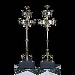 A pair of large brass Gothic Revival antique candelabra