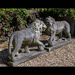 A pair of reconstituted stone 20th century copies of the Medici Lions