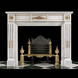 12954: A Louis XVI style gilt ormolu chimneypiece in white Statuary Marble. The central plaque, decorated with sprays of laurel surrounding a small wreath of entwined roses is flanked by plain gilt ormolu be