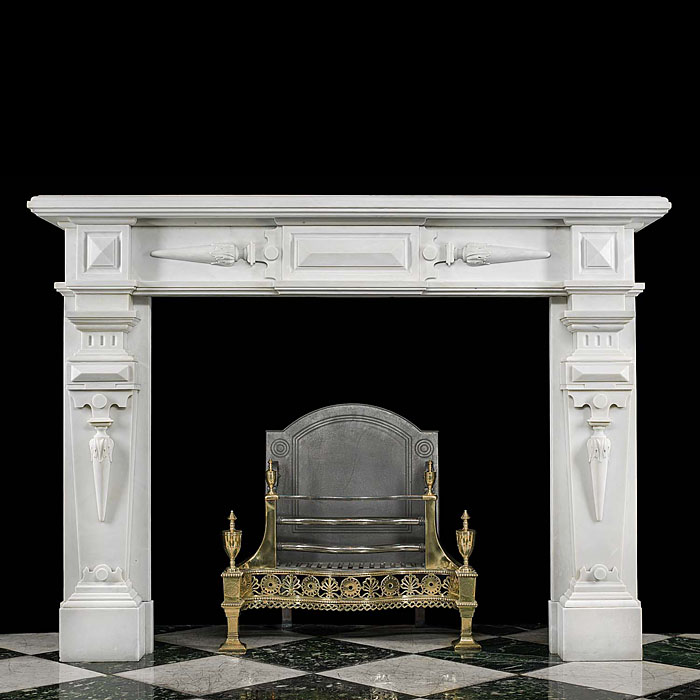 12993: A marble fireplace, of considerable size, in Bianco Pi marble in the Jacobean manner. The frieze, end blocks and jambs carved in traditional Geometric Gothic design all supported on plain square foot