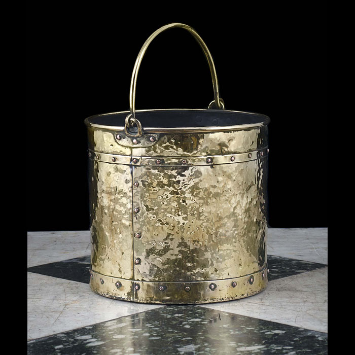 A 20th century hammered brass coal bucket