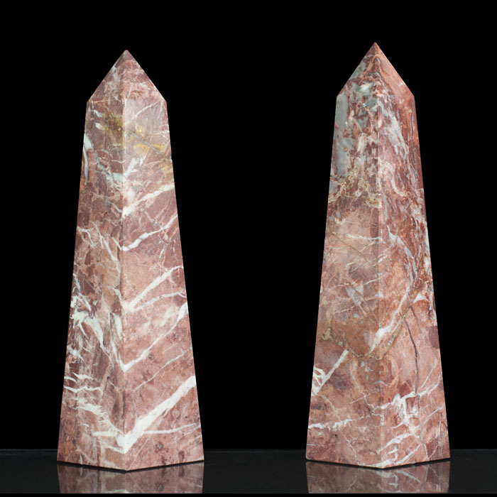 A pair of small Rouge Royal Marble obelisks
