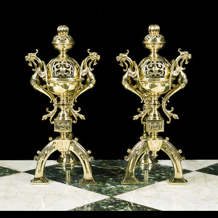 A pair of Antique brass fire tool rests or chenets