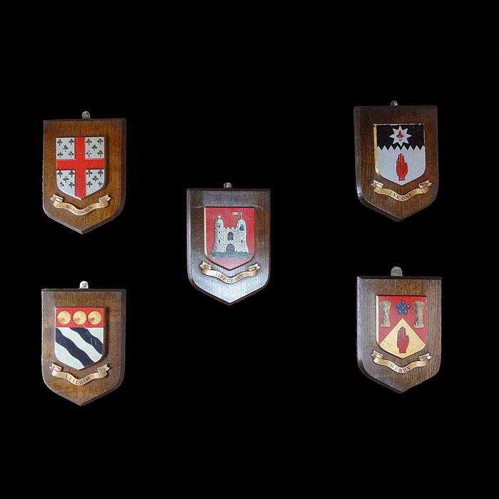 A set of five small Irish shield crests
