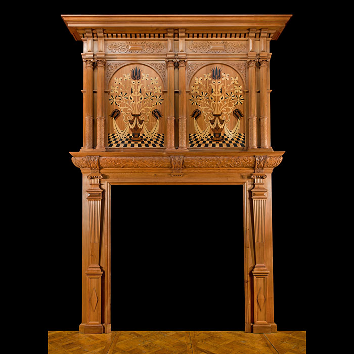 A fine and tall Victorian Jacobean Revival inlaid Cedar wood Fireplace