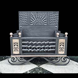 An Aesthetic Movement wrought iron and copper Antique Fire Grate