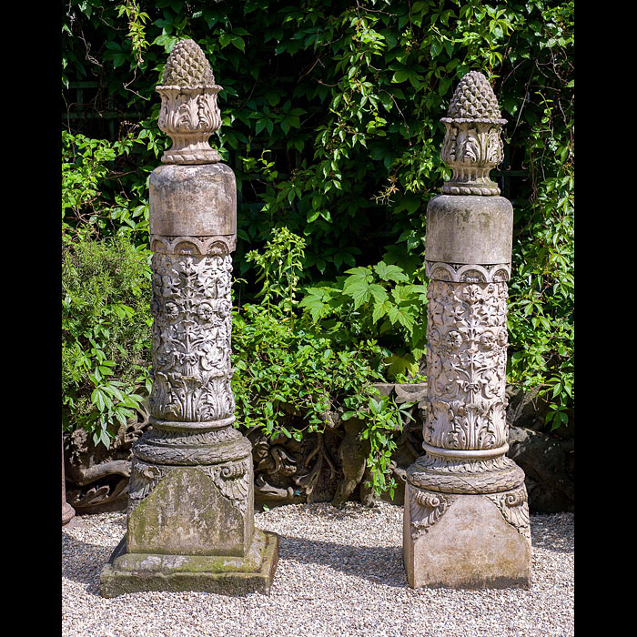A pair of Pineapple topped antique terracotta pillars