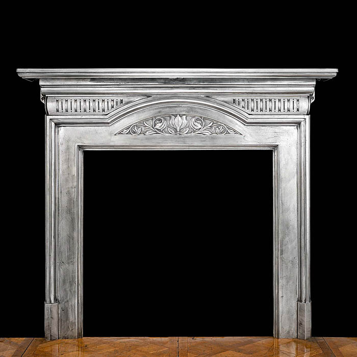 A cast iron Art Nouveau style antique chimneypiece