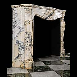 An Antique French Pavonazzetto Bianco Marble fireplace surround