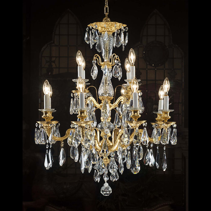 A twelve light antique cut crystal and bronaze chandelier