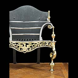 A Rococo style 20th century brass and iron fire basket