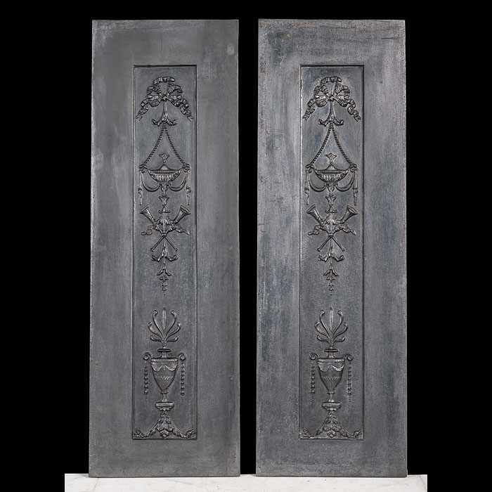 A pair of neoclassical style antique fireplace panels