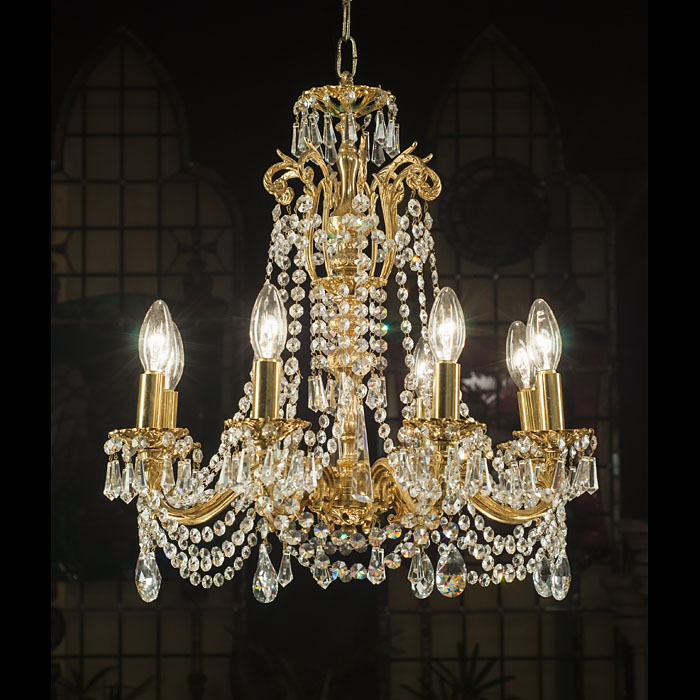 A cut crystal & brass eight light chandelier