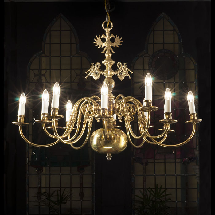 A 20th century ten branch brass Baroque style chandelier