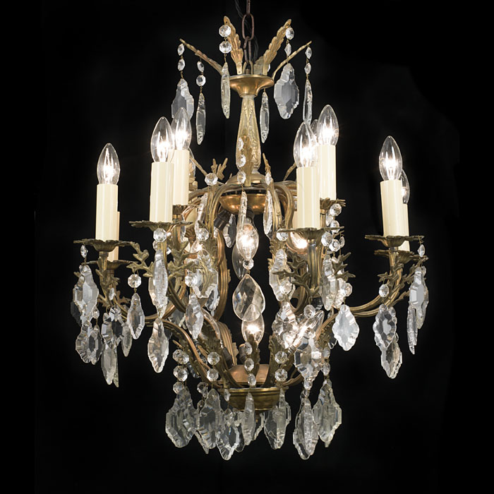 A twelve light 20th century cut glass and bronze chandelier