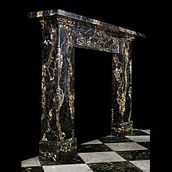 13275: An elegant, beautifully veined Portoro marble English Regency fireplace, with a large and substantial shelf supported on slightly tapering jambs, with symmetrical veining and mounted on impressive foo