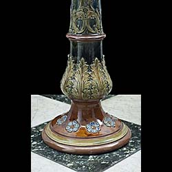 An antique Royal Doulton Jardiniere stand