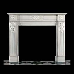 13325: A finely carved a rather lovely late Regency early Victorian fireplace in the Louis XVI manner, in pure white Statuary marble with decorative acanthus leaves adorning the central frieze. Circa 1840.