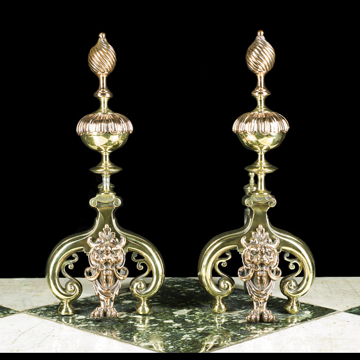 A pair of Antique Baroque style copper & brass firedogs