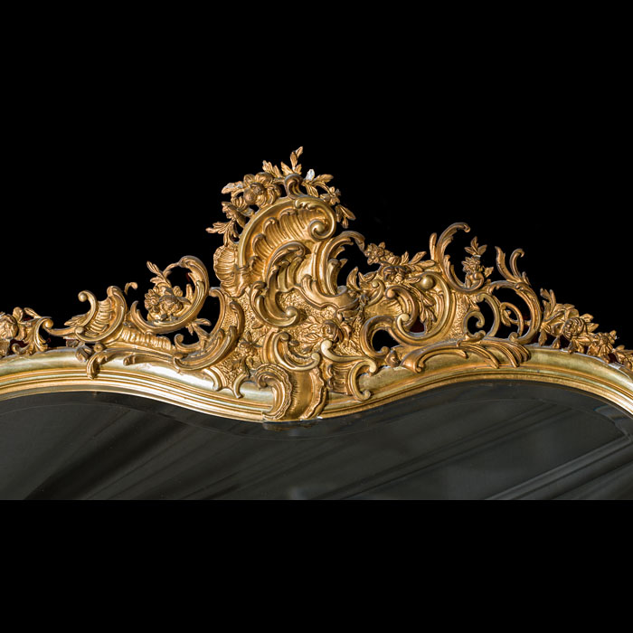 A grand carved gilt wood Victorian Rococo over mantel mirror