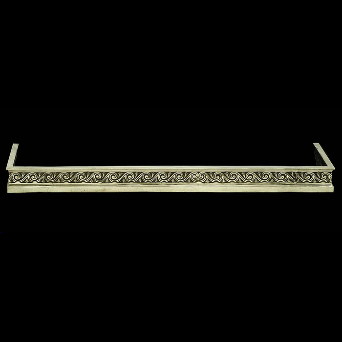 A Neo Classical style Antique brass Fireplace Fender