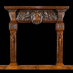 A tall Renaissance style Carved Oak Antique Fireplace Mantel