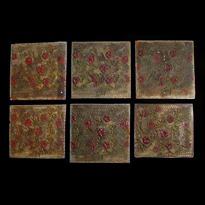 An antique set of six painted leather panels