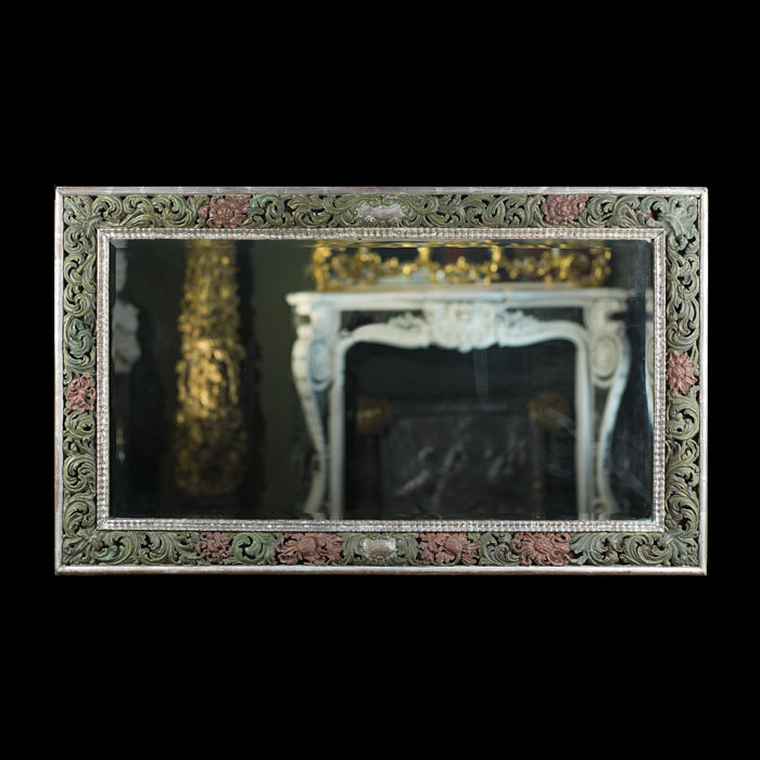 An unusual carved and painted antique wall mirror