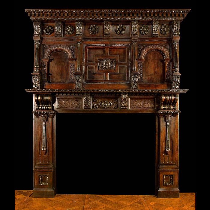 A Tall Carved Tudor Rose Oak Jacobean Revival chimneypiece