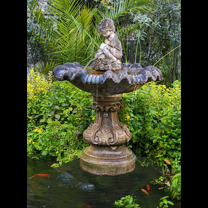 An Italian style 20th century composition stone fountain