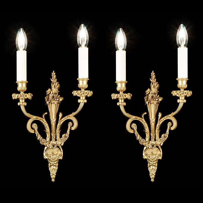 A pair of antique brass Regency style wall lights