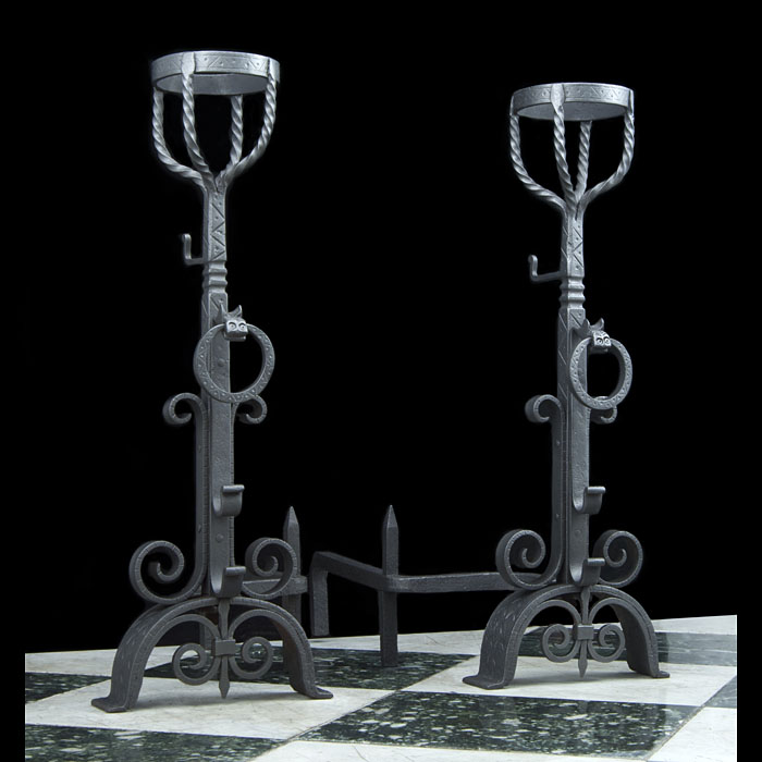 A pair of Jacobean style wrought iron cresset andirons