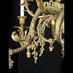 A 19th century antique 12 branch brass Rococo style chandelier