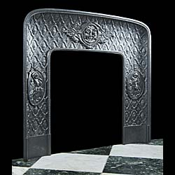 A Louis XVI antique cast iron fireplace insert