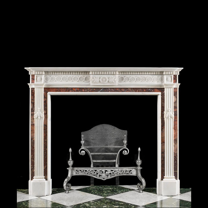 13469: A small very decorative early 20th century Neoclassical style fireplace in statuary and antique red brown fossil marbles with an egg and dart moulded shelf over a guilloche frieze and central plaque a