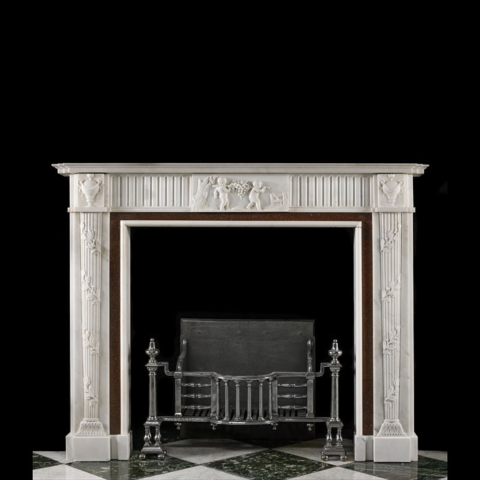 13470: An early 20th century Neo Classical style white statuary & porphyry marble fireplace surround, the fluted frieze centred with a 19th century tablet depicting putti gathering a grape harvest, with swag