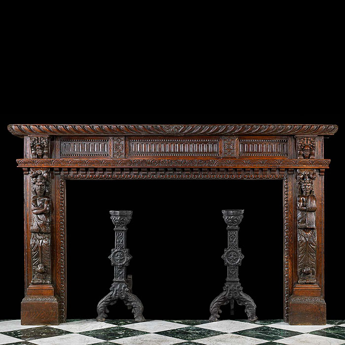 A Wide Carved Oak Jacobean Style Fireplace