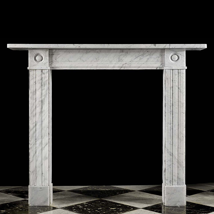 13488: One of a pair, with  SNo 13712, of small elegant Victorian bullseye fireplace surrounds in richly veined Carrara Marble.English, circa 1840.     Link to: Antique Victorian, William IV, Arts and Crafts