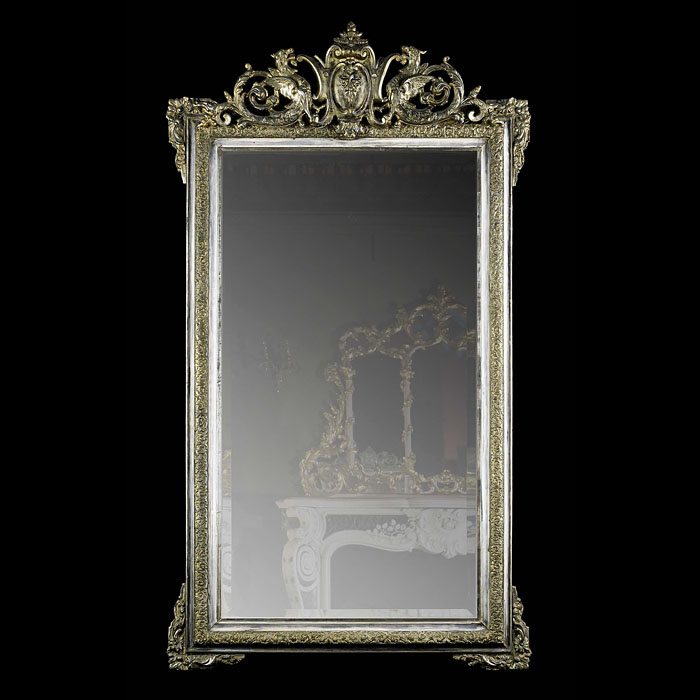 A silvered wood antique French wall mirror