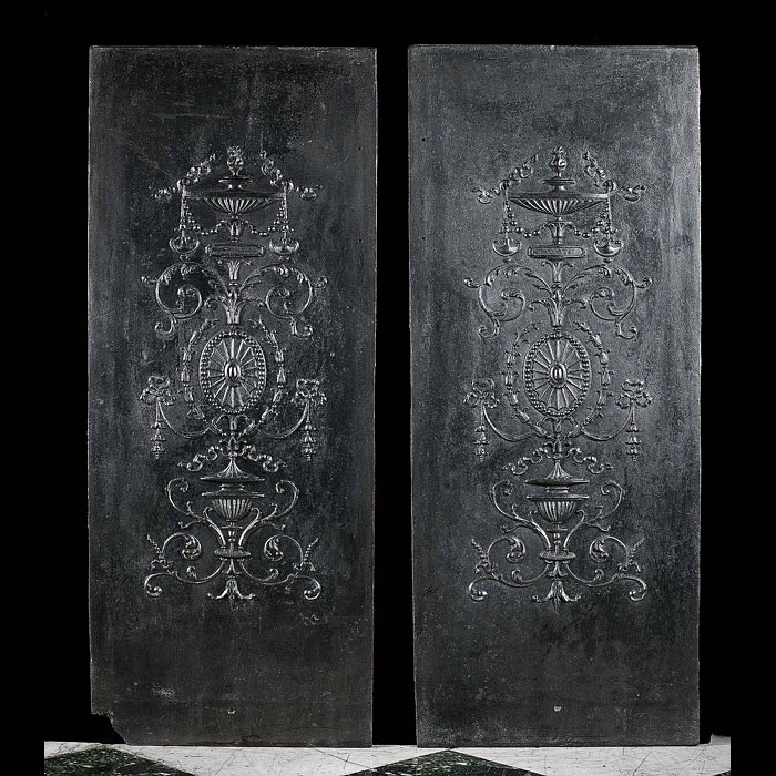 A French pair of cast iron internal fireplace panels