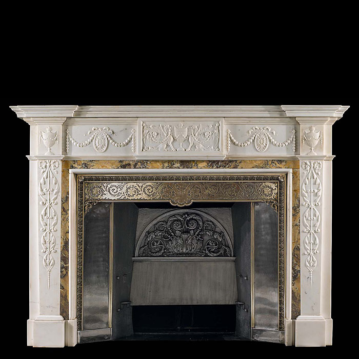 13521: A decorative 19th century statuary and siena marble chimneypiece with an 18th century tablet depicting mythological beasts and an urn flanked by swagged paterae and further urns on the enblocks. Shown