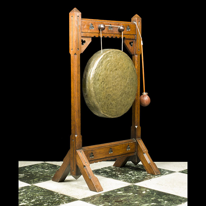 An Antique carved oak Arts & Crafts dinner gong