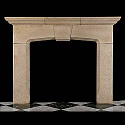 13531: A Tudor style arched Clipsham limestone fireplace with a graduated moulded shelf, the header with a keystone and the shaped aperture terminating in lip moulding.English mid 20th century.    Link to: A