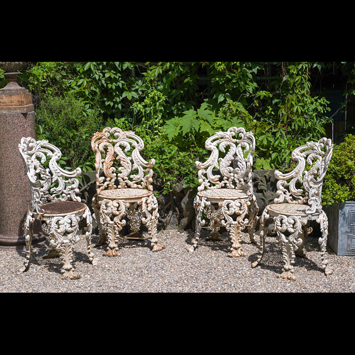 Four cast iron ornate Rococo style Victorian garden chairs