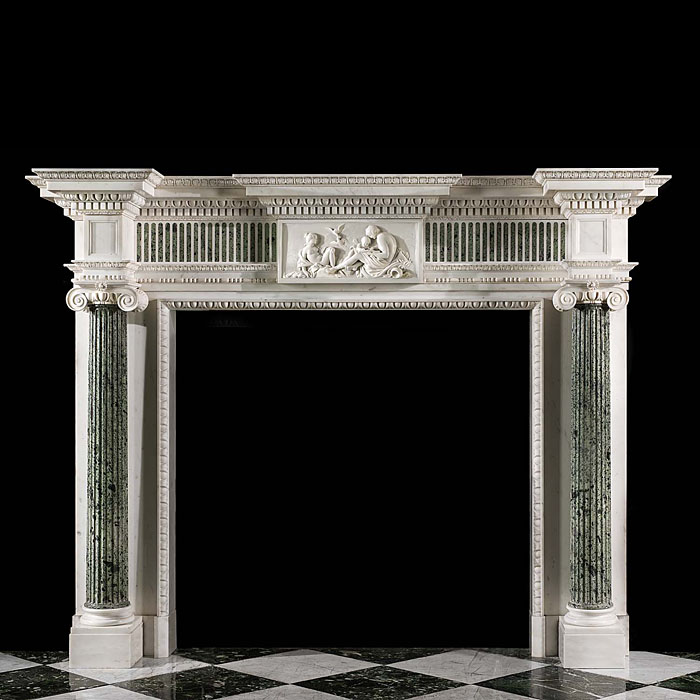 13578: A stately and very well proportioned Neoclassical style breakfront chimneypiecein statuary and verde antico marble. The freeze, inlaid with verde antico blindflutes and  centred by a finely carved 18t