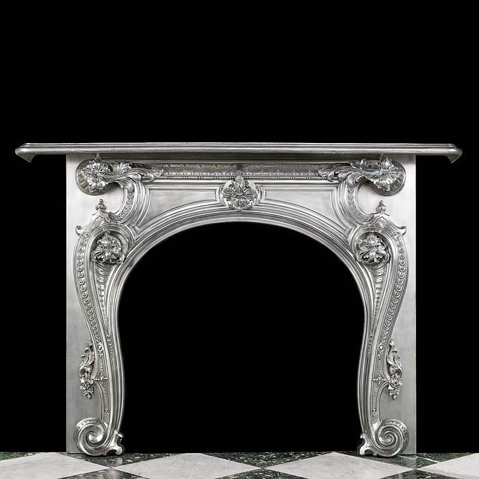An antique cast iron French Rococo Fireplace Surround