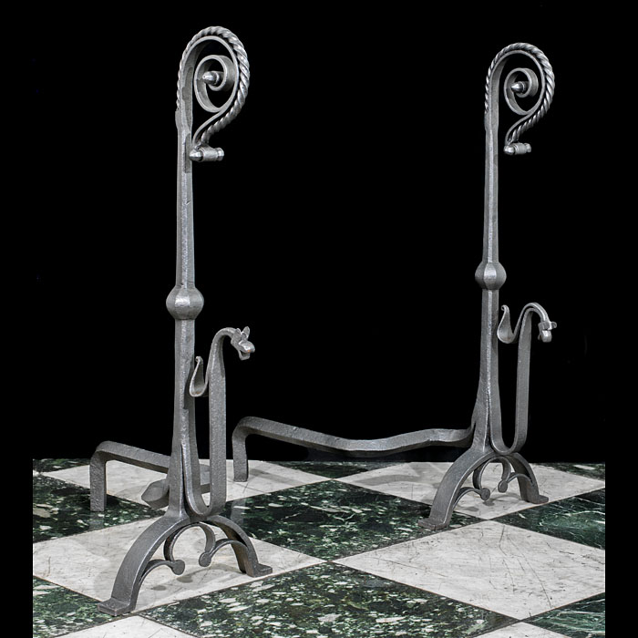 A pair of wrought iron Jacobean style antique andirons